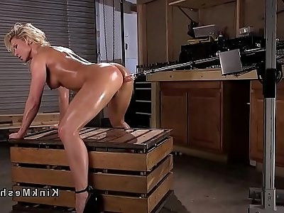 Busty blonde babe gets fucking machine in ass