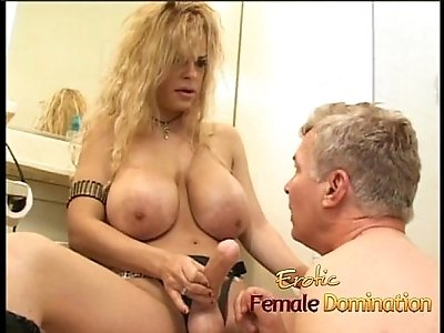 Latex clad busty wench fucks a horny stud with strap