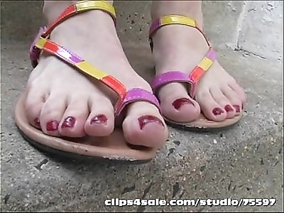 Hot blonde milf takes sandals off in Public